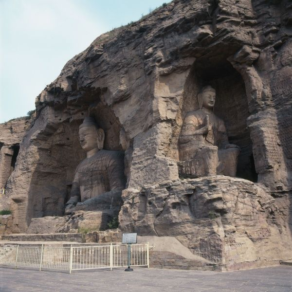 Two seated Buddha statues carved from the rock at the Yungang (Cloud Ridge) Caves or Grottoes in Datong, Shanxi Province, in the People's Republic of China