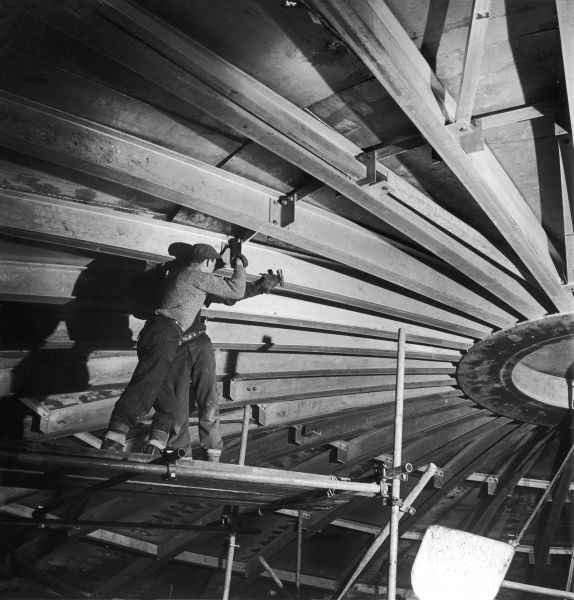 Two welders work on the domed aluminium roof of a large liquid methane tank at Canvey Island. Photograph by Heinz Zinram