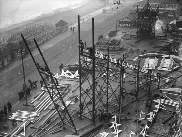 Huge scaffolding erected for the construction of a wooden rollercoaster on the seafront - part of the 'Merrie England' funfair at Ramsgate, Kent, England