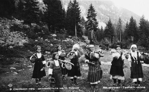 Bulgaria - Borovets - Women return home with baskets of berries. Borovets is now a popular Bulgarian ski resort