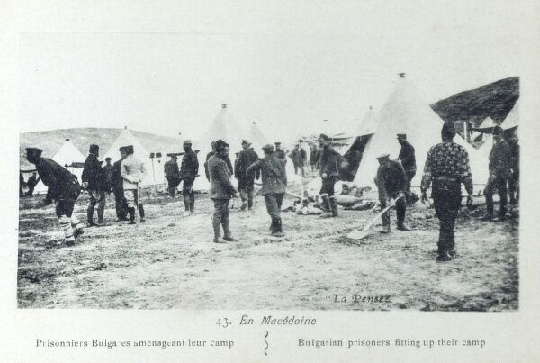 Bulgarian prisoners in Macedonia, captured during the repulse of Bulgarian attacks into the region during the Second Balkan War, which broke out on 16th June 1913. Here the prisoners fit out their camp, levelling ground and constructing tents