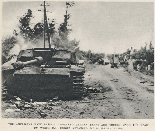 Wrecked German tanks and trucks on a Normandy road, shortly after 'D-Day', 6th June 1944. This road was taken by advancing American troops on their way inland from the invasion beaches