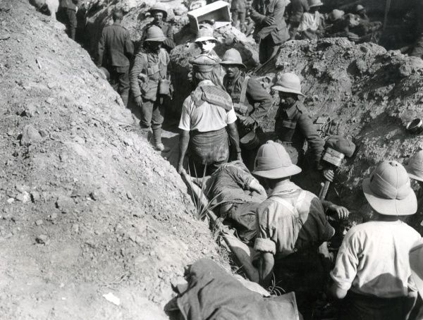 A busy communication trench in Mesopotamia (now Iraq) during an action, with walking wounded and stretcher cases, during the First World War. Date: circa 1915-1918