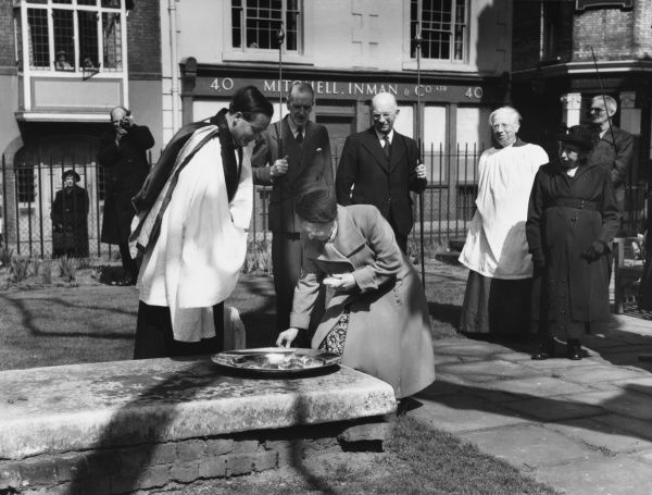 ENGLAND: BUTTERWORTH DOLE & WIDOW'S SIXPENCE, St Bartholomew the Great, Smithfield, London. On Good Friday widows over 60 receive a sixpence & Hot X bun