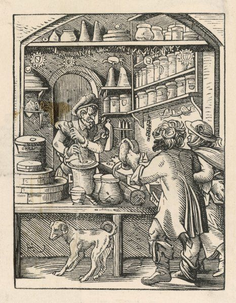 MEDICINES WHILE YOU WAIT: a druggist of the 16th century prepares a medicament, pounding the ingredients with pestle and mortar while two customers wait with their dog. Date: circa 1570