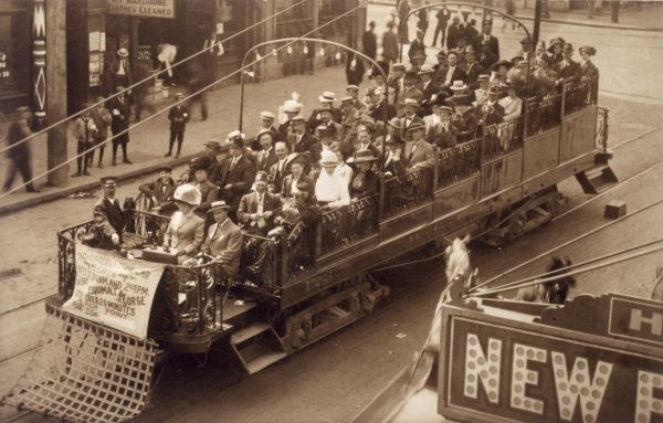 Sightseers fill an 'Observation Car' in Vancouver Island, Canada - somewhat like a charabanc
