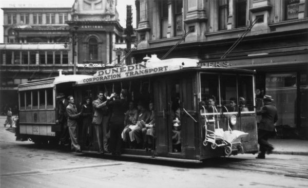 A crowded cable car in Dunedin, New Zealand. Note the pushchairs hanging off the front of the car