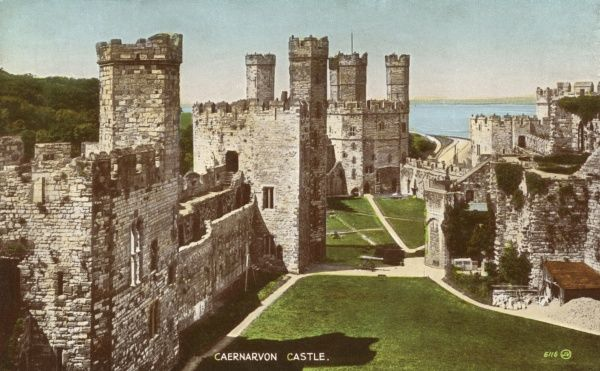 View of Caernarfon (Caernarvon) Castle in Gwynedd, North Wales. The castle was built by the English King Edward I from around 1283, on the site of a Roman fortress and Norman motte. Date: 1950s