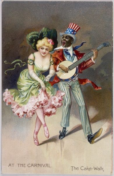 A black banjo-player and his white partner, both in carnival costume - is this New Orleans ? - perform the cake- walk