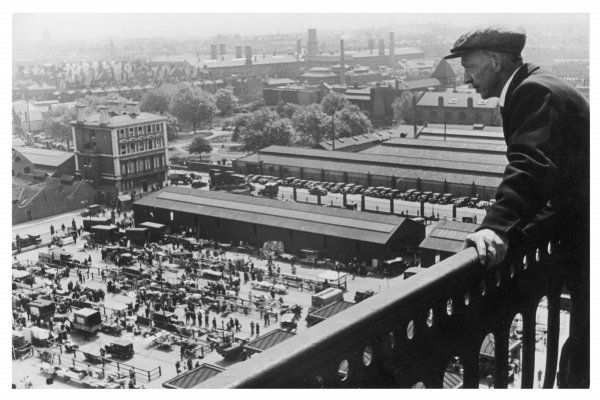 A man looks down over the old Caledonian Road market, Caledonian Road, North London
