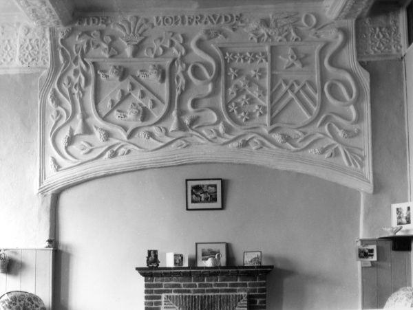 Plasterwork in the old kitchen of CALGARTH HALL, on the banks of Lake Windermere, Cumbria, England, bearing the armourial shields of Christopher Philipson and Elizabeth Wyvil. Date: 16th century