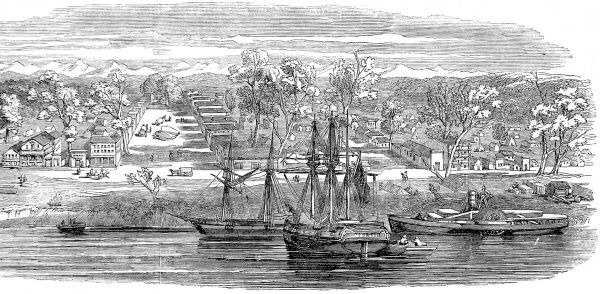 The beginnings of the City of Sacramento have been laid out in a grid, with wide avenues. The view is from the river, where sailing boats and a paddle steamer are at anchor