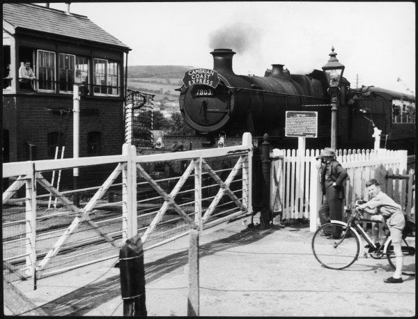 The Cambrian Coast Express steam locomotive train, at Llanbadarn crossing, near Aberystwyth, Wales