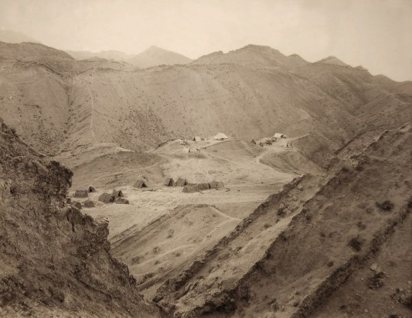A temporary camp in the mountains of Iran, close to oil exploration works undertaken in the early 1920s by British Petroleum. The site is labelled as the 'Golden Stairs en route to Gach Qaranguli', which is likely to be close to Gachsaran