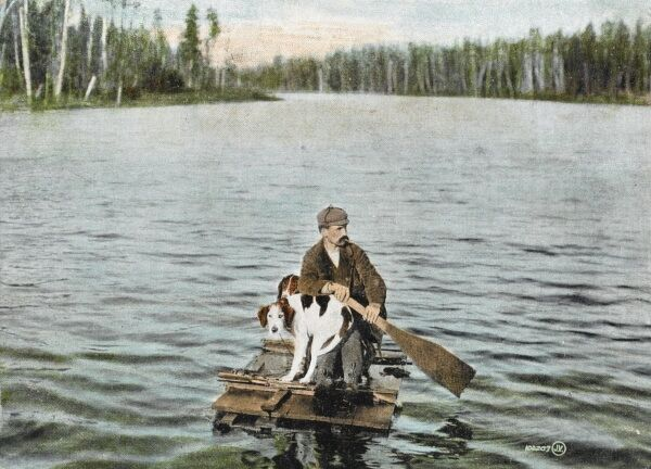 Ontario - Highlands - Canadian man and his dogs heads off derrhunting on one of the more improbably rafts one could imagine