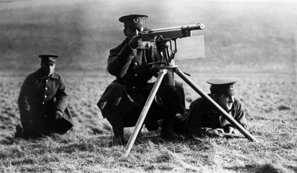 Three Canadian machine gunners with a Colt-Browning M1895, nicknamed a Potato Digger, on the Western Front in France during the First World War. Date: circa 1915