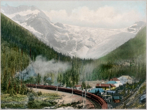 The Canadian Pacific Railway at the Great Asulkan Glacier in the Canadian Rockies. The Glacier Hotel is beside the railway