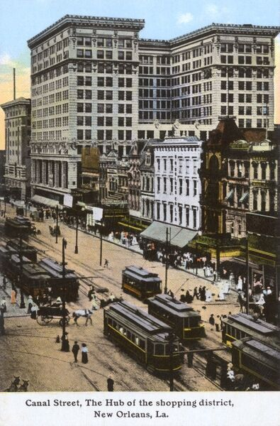 Canal Street, New Orleans, Louisiana, USA - the main business thoroughfare of the city. This card shows a portion of the 'retail shopping district', which is captioned on the card as 'one of the widest and busiest streets in the USA&#39