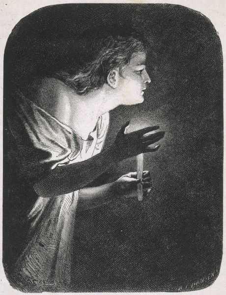A girl uses a candle to light her way