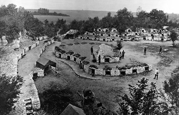 A terraced colony of dug-outs for French ambulance dogs. Dogs were used extensively during World War I as scouts, sentry and ambulance support