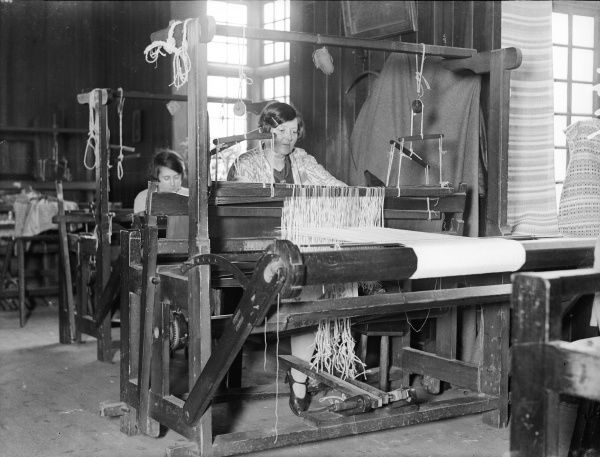 Women weavers weaving at their looms in Canterbury, Kent, England