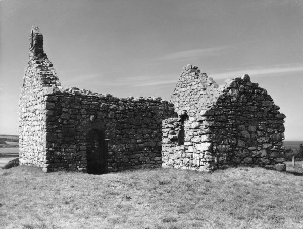 The roofless ruins of the tiny chapel of Capel Lligwy, Isle of Anglesey, Wales. Date: Medieval