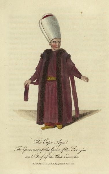 The Capi Aga, the Governor of the Gates of the Seraglio and Chief of the White Eunuchs. He is wearing a high white turban and crimson fur-trimmed robes. He has no beard