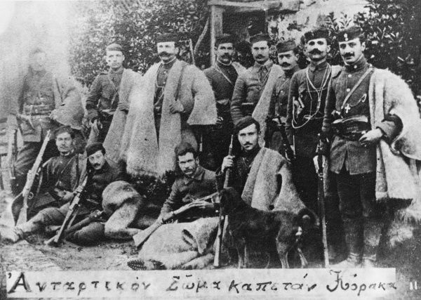 Captain Korakos (standing left of centre) and his guerillas, who fought on the Greek side during the Struggle for Macedonia in opposition to Bulgarian guerillas. Korakos later became a Greek general