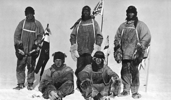 Photograph showing Captain Scott and his sledge team at the South Pole, 18th January 1912. Left to right, standing: Lt. Oates, Captain Scott, Petty Officer Evans. Seated, left to right: Lt. Bowers and Dr. Wilson. This photograph was taken by Lt