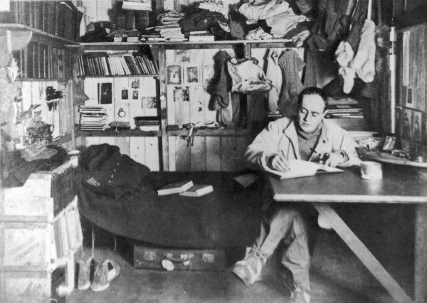 Captain Robert Falcon Scott (1868 - 1912), British polar explorer and leader of the ill-fated expedition to the South Pole in 1912, pictured in his work room on board the Terra Nova