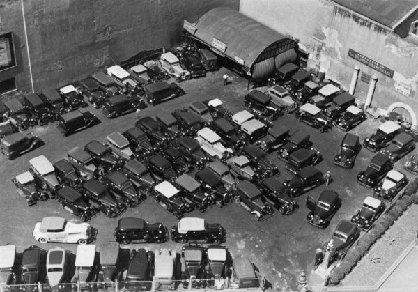 An elevated view of a car park or car showroom or sales area, South America. Date: 1930s