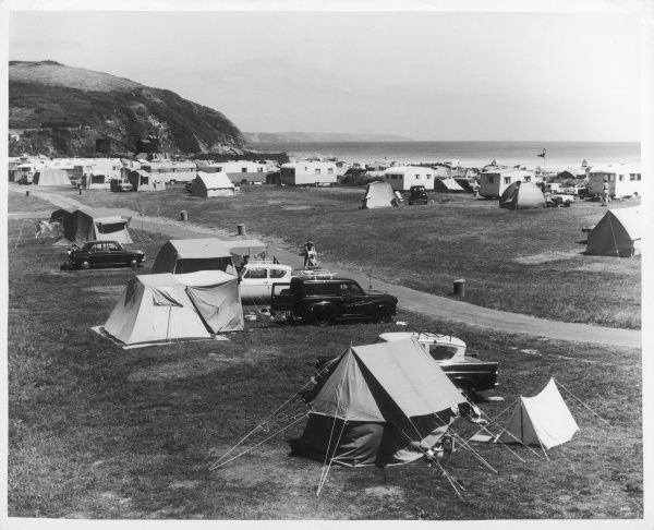 Cars and tents at the Pentwan caravan park, on the Cornish coast at Mevagissey, England