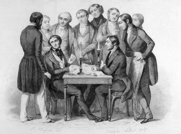 Two men play a serious game of cards while several others crowd round watching; one of the players seeks advice on his hand from a bystander