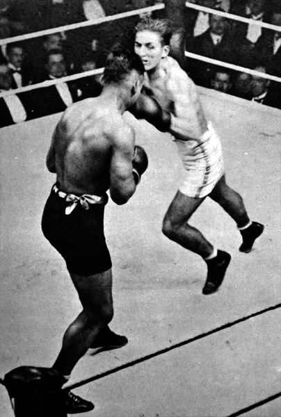Photograph showing Georges Carpentier (white shorts) punching Joe Beckett during their fight for the Heavyweight Championship of Europe, 4th December 1919