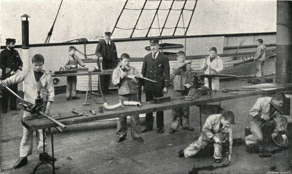 Boys learning carpentry and plumbing on the Training Ship Wellesley, on the River Tyne at North Shields, Northumberland