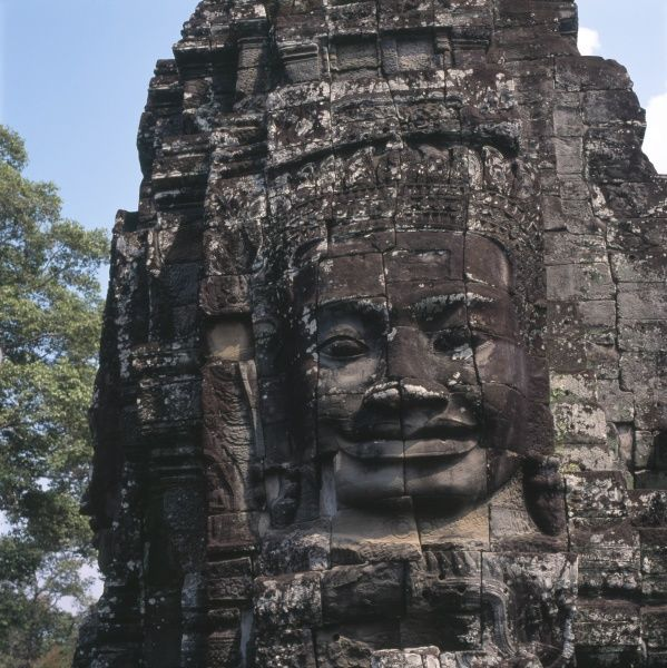 Detail of the carving of a large human face at the Wat Bayon Khmer Buddhist temple at Angkor Thom, Siem Reap, Cambodia, built in the late 12th and early 13th centuries