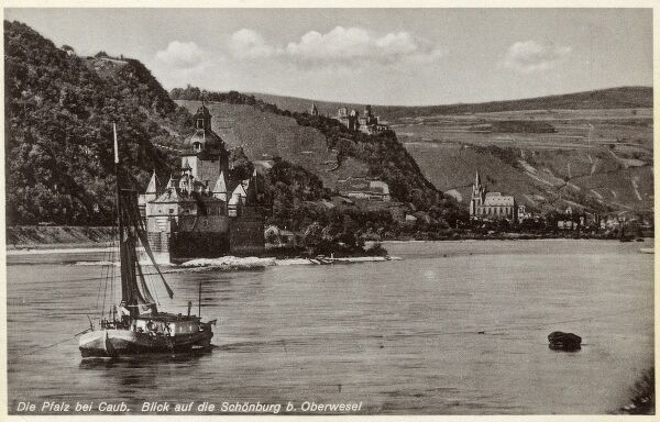 The Castle Pfalz, or Burg Pfalzgrafenstein in the foreground on the River Rhine, Germany. Burg Gutenfels (Castle Caub) can be seen in the distance, nestling over the Town of Kaub. Date: circa 1920s