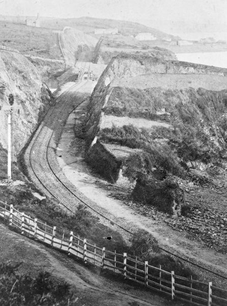 View of the Great Western Railway at Castle Pill (pill is a local name for a tidal inlet), near Milford Haven, Pembrokeshire, South Wales. Brunel's broad gauge tracks can be seen, as well as his 'disc and crossbar' signalling. &quot
