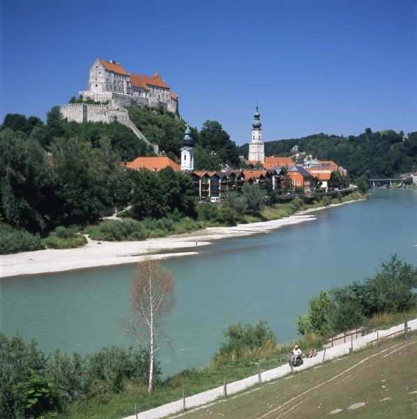 View of the gothic castle across the Salzach River in the city of Burghausen, south east Bavaria, Germany. The castle, on top of a ridge, is the longest castle complex in Europe. The parish church of St Jakob can also be seen, with a dome on its spire