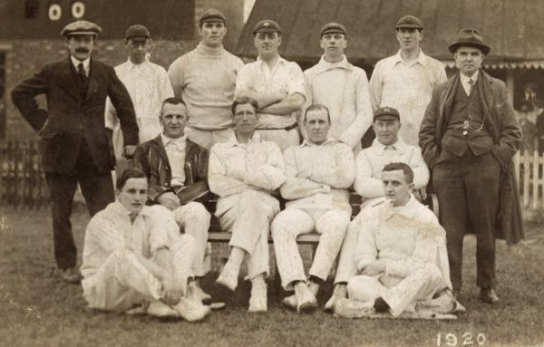 A group photo of the Castleford Cricket Team, Yorkshire, with umpires on either side. Date: 1920
