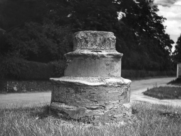 The base of an ancient cross at Caston, Norfolk, England. Date: 1930s