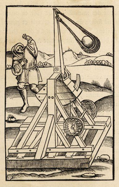 A rather lethal looking catapult with a huge sling on a wooden base
