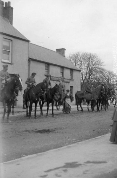 A cavalry parade pauses outside the Plough and Harrow pub in Haverfordwest, Pembrokeshire, Dyfed, South Wales, probably around the time of the outbreak of the First World War