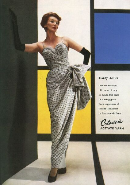 Barbara Goalen modelling a dress created by Hardy Amies out of Celanese jersey fabric. Date: 1953