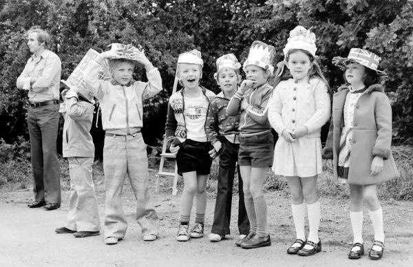 Children line up ready to be judged in the best hand-made hat competition during Silver Jubilee celebrations in Essex