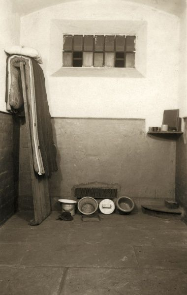 The interior and meagre contents of a cell at Wakefield Prison, West Yorkshire. The inmate sleeps on a plank bed covered by a thin mattress. The prison was originally built as a House of Correction in 1594