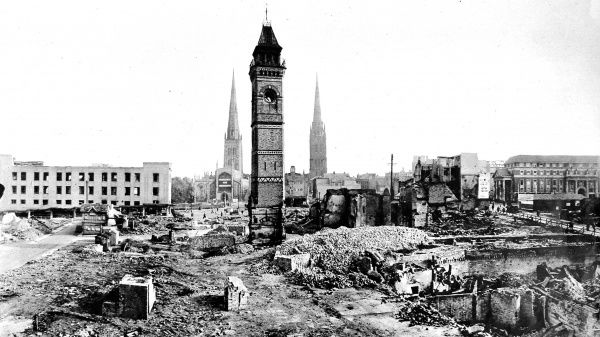 Photograph showing the centre of the city of Coventry, with the clock tower still standing but surrounded by debris, 1941. Coventry was heavily bombed during 1940 and much of the city centre, including the cathedral, was destroyed