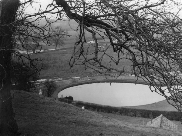 Chadwell Spring, near Ware, Hertfordshire, England, which fills this basin all winter and promotes the flow of the New River towards London. Date: 1930s