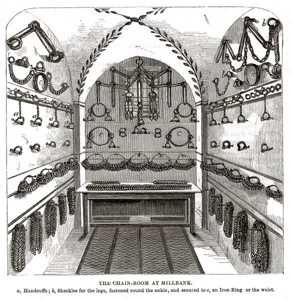 The chain room at Millbank Prison, London. The walls are lined with chains, shackles and handcuffs. Date: 1862