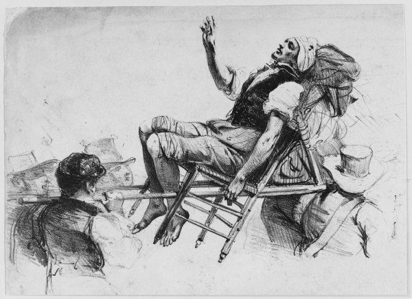 A casualty of the street fighting is carried away on a chair